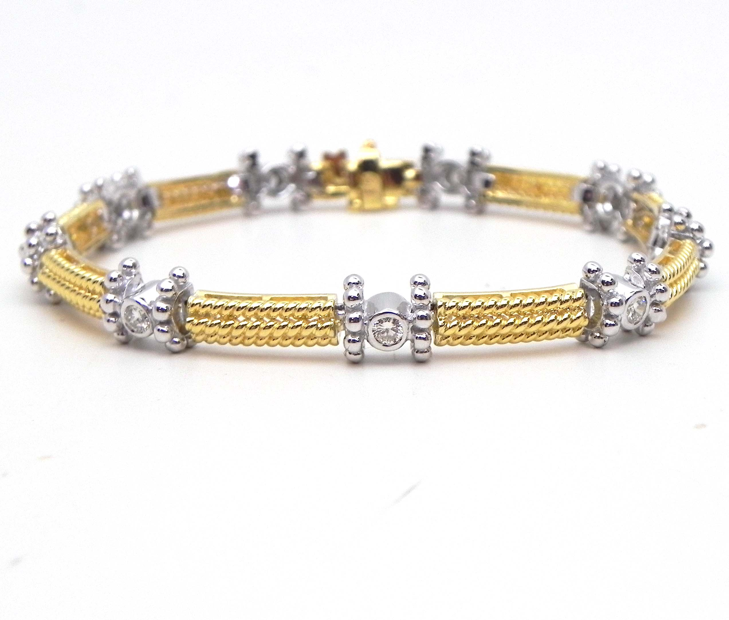 brilliant diamond set designed an as pin stylised articulated series bracelet links of bow with bezel