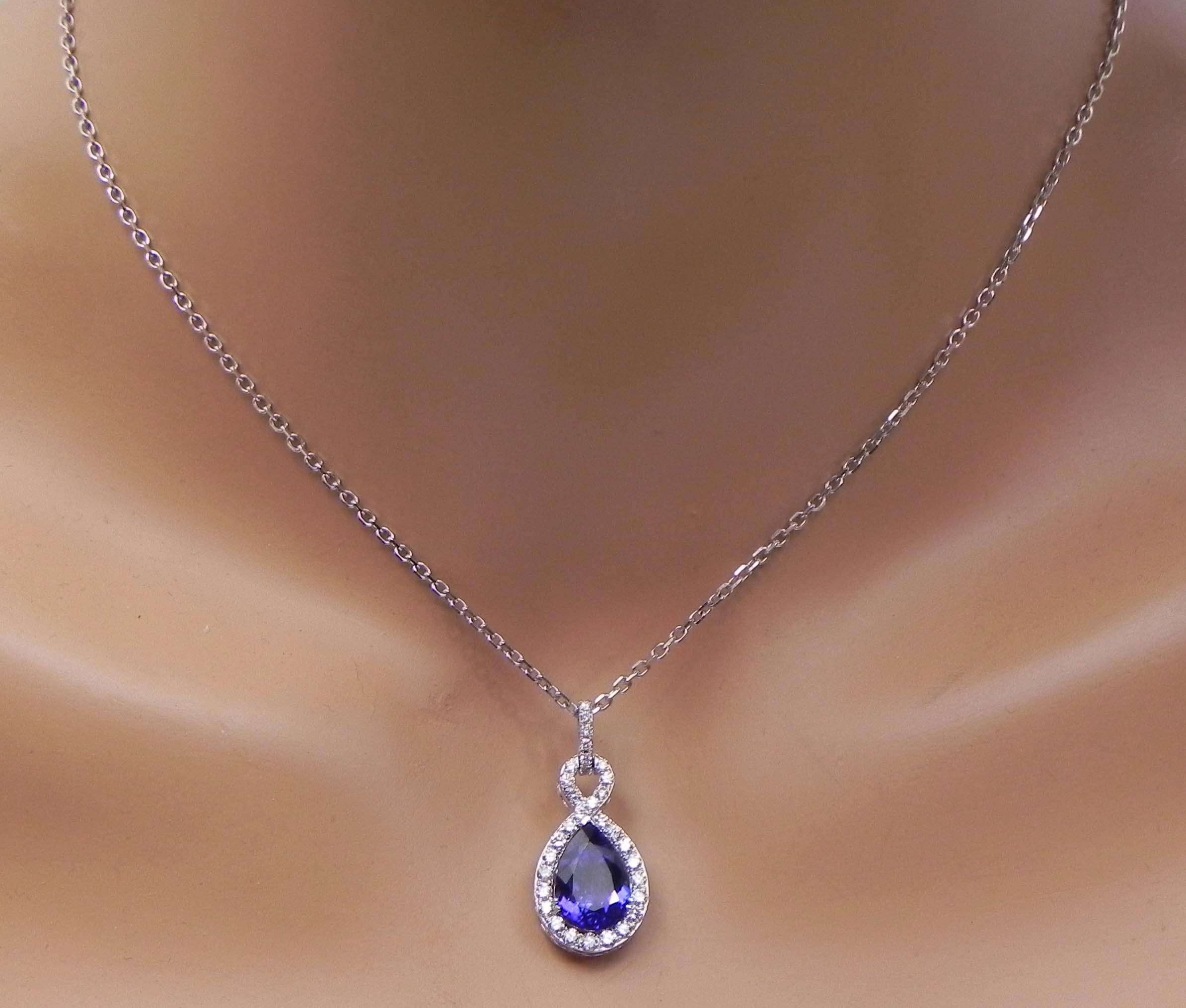 La s 18k White Gold 4 Cts Pear Shaped Tanzanite Diamond Halo